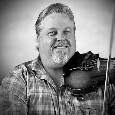 John Schreiber teaches 5 String Banjo, Tenor Banjo, Guitar, Ukulele, Mandolin, Bass, Fiddle, Irish Bouzouki, Didgeridoo, Bodhran, Beginner Penny Whistle, Beginner Piano